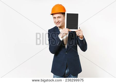 Young Smiling Businessman In Dark Suit, Protective Hardhat Holding Tablet Pc Computer With Blank Scr