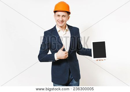 Smiling Businessman In Dark Suit, Protective Hardhat Holding Tablet Pc Computer With Blank Screen An