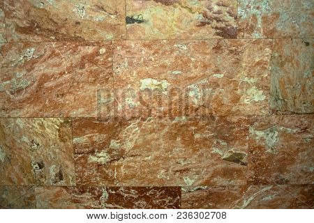 Natural Pattern Of Polished Beige And Brown Marble Facing Plate. Contemporary Expressive Element For