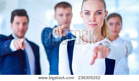 Group of business people pointing to you . Group of business people