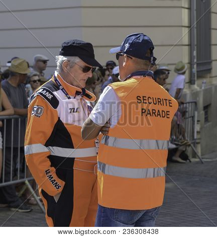 Le Mans, France - June 16, 2017: Back Of A Security Guard And A Pilot At The Parade Of Pilots Racing