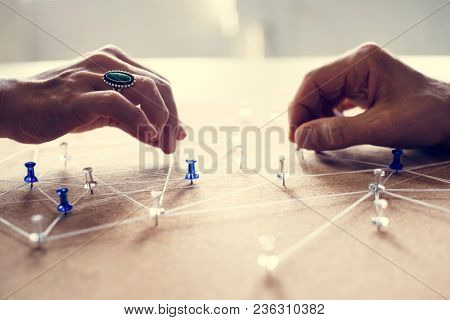 Hands holding connecting pin network