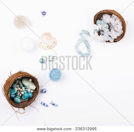 Feminine Workplace In Blue And Aqua Colores In Flat Lay Style. Gemstones, Glass Beads, Shell Beads I