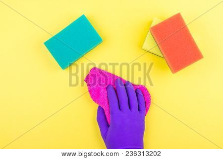 Cleaning, Housekeeping, Home, Clean Up. Hand In Purple Rubber Glove Cleaning Surface With Pink Micro