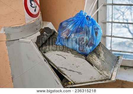 Garbage Bag Full Of A Garbage Lying In A Lid Of A Home Garbage Chute In Moscow Dwelling House