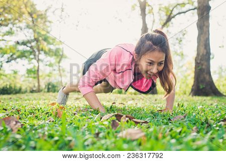 Asian Young Woman Warm Up Her Body By Push Up To Build Up Her Strength Before Morning Jogging Exerci