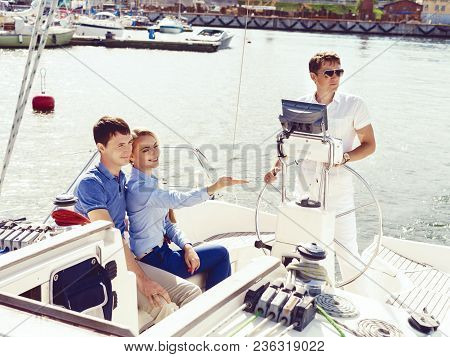 Happy And Beautiful Couple Traveling A Yacht. Summer, Holiday, Vacation Concept.