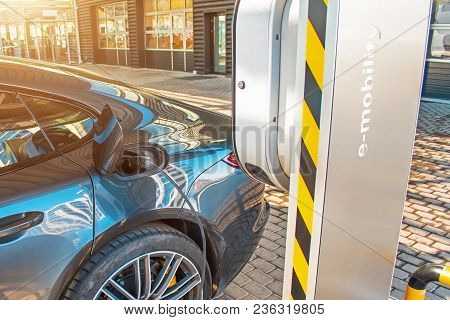 Automobile Refueling For Electric Cars E-mobility In The Background E-car, Wheel. Charging E-car, Th