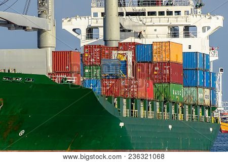 Labuan,malaysia-april 6,2018:cargo Ship,full Of Shipping Containers In The Port Of Labuan,malaysia.i