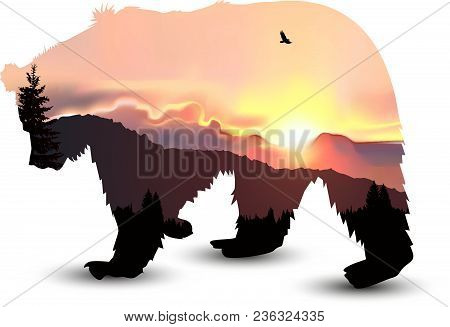 Silhouette Of Bear With Coniferous Trees On The Background Of Mountains And Colorful Sky. Sunset.