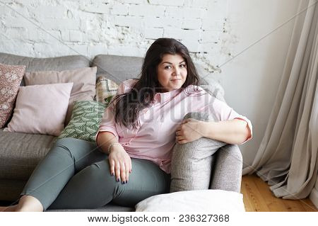 Joy, Rest, Relaxation And Happiness Concept. Picture Of Body Positive Attractive 25 Year Old Woman W