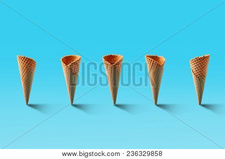 Ice Cream Cones Pattern. Turquoise Background. Sweet, Summer And Empty Concept. Top View. Flat Lay.