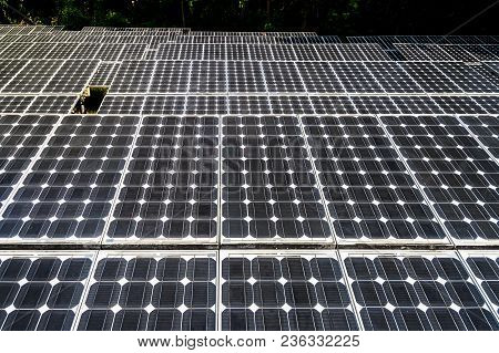 Solar Panels With The Sunny Sky. Black Solar Panels. Background Of Photovoltaic Modules For Renewabl