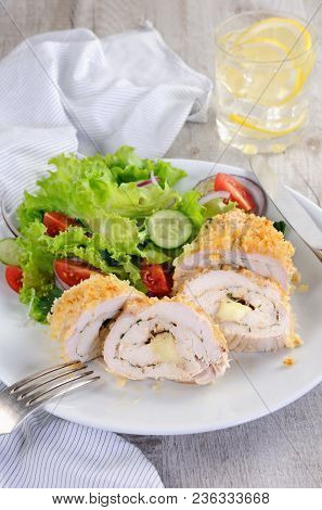 Sliced Baked Until Golden, Crispy Crust Chicken Roll In Breadcrumbs With Parmesan Cheese, Stuffed Wi