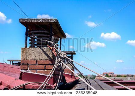 Tied Ropes Of Industrial Climbers Around Chimney Made Of Bricks.