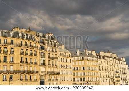 Ancient Stone Building In Paris, France, With A Sunrise Light