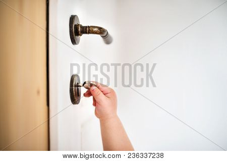 Unrecognizable Toddler Child Locking Door. Domestic Accident. Dangerous Situation At Home.