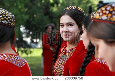 Ashgabat, Turkmenistan, May 25, 2017: Portrait Of An Unknown Female Student In A Red National Dress