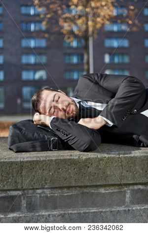 Overworked businessman or employee takes a nap