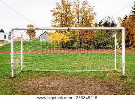 Old Vacant Football Soccer Goal Gate In Rural Grass Field.
