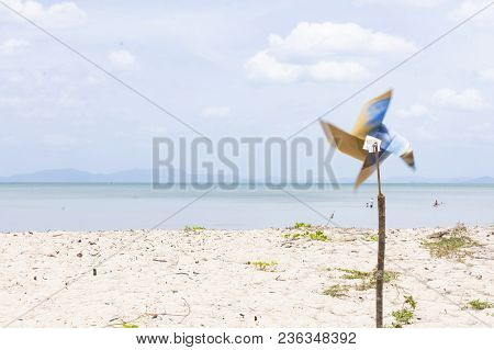 Wind Turbine With The Beach.or Wind Turbine With Background The Sea.