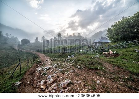 Beautiful Rural Scene On A Foggy Morning With A Country Road And Fences, Fundatura Ponorului, Hunedo