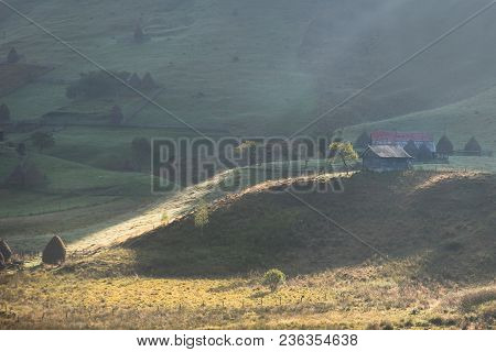 Beautiful Rural Mountain Landscape In The Morning Light With Fog,old Houses And Haystacks, Fundatura