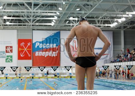 ST. PETERSBURG, RUSSIA - APRIL 11, 2018: Swimmer during warm up time of All-Russian Swimming Competitions Merry Dolphin. The competitions was founded in 1965
