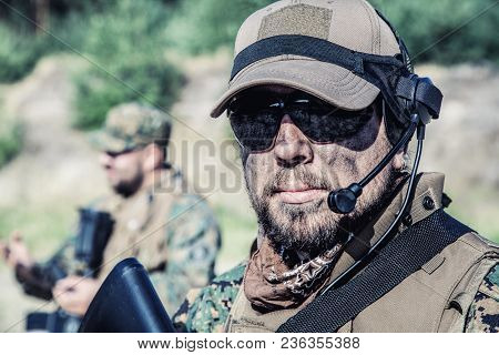 Location Shot Of United States Marine With Rifle Weapons In Uniforms. Military Equipment, Army Helme