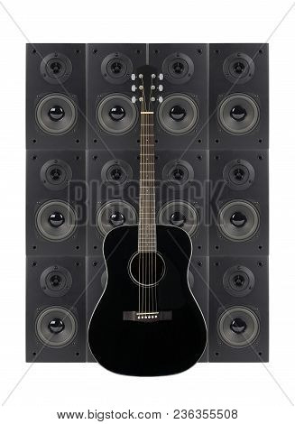 Music And Sound - Black Guitar On A Loudspeaker Enclosure Background. Isolated