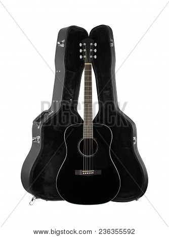 Musical Instrument - Front View Black Acoustic Guitar In Hard Case  Isolated On A White Background.
