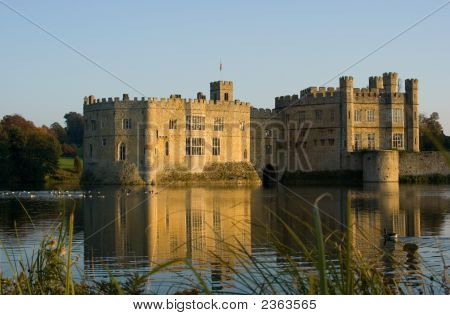 Old English Castle Protected By A Moat