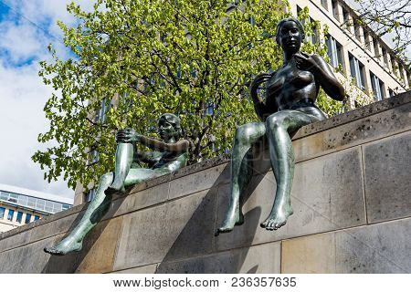 Berlin, Germany - April 16, 2017: Part Of The Three Girls And A Boy Statue By The Spree River On Apr
