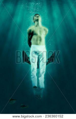 Man floats underwater. Horrible dream