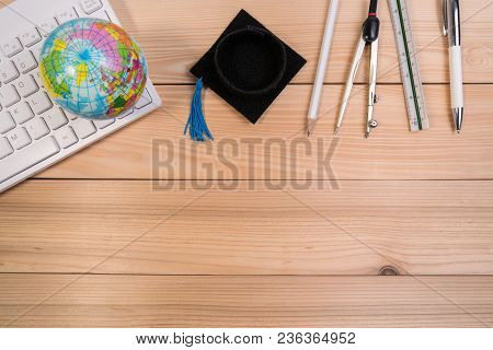 Top View Of School Accessories On Education Table Desk With Education Supplies, Blank Note Pad, Calc