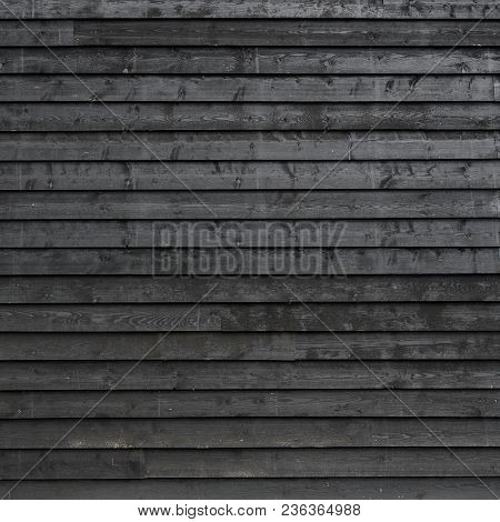 Square Part Of Black Painted Wooden Planks Of Barn Wall Or Shed