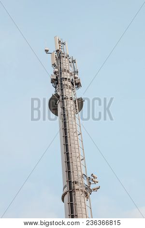 In The Port Of An Industry There Is A Mobile Phone Mast