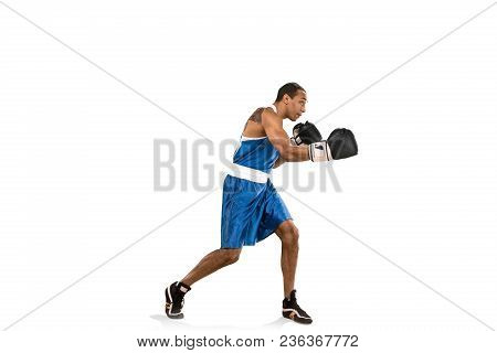 Sporty Man During Boxing Exercises. Photo Of Boxer On Isolated On White Background. Strength, Attack
