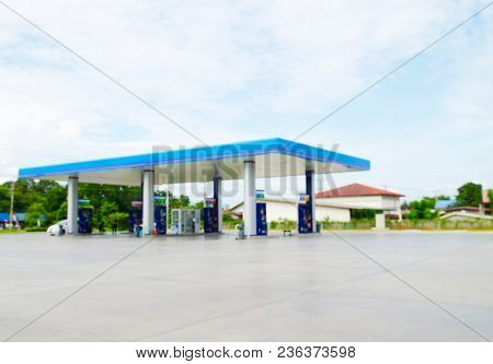 Blurred Abstract Background And Can Be Illustration To Article Of Car Fueling At A Gas Station