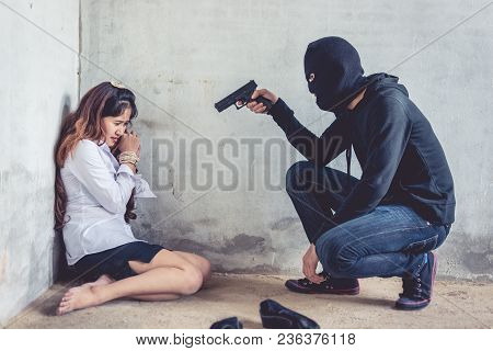 Ransom Shooter Aiming His Gun At The Hostage. Terrorist And Robber Concept. Police And Soldier Theme