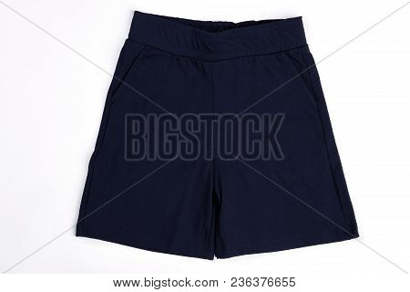 Toddler Boy Dark Cotton Shorts. Close Up Of Casual Textile Shorts For Infant Boy. High Quality Child