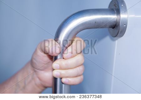 Asian Senior Or Elderly Old Lady Woman Patient Use Toilet Handle Security In Nursing Hospital Ward :