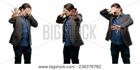 Handsome young man stressful and shy keeping hand on head, tired and frustrated