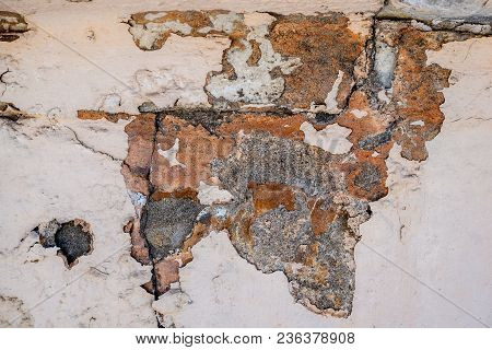 Background Of Natural Cement Plaster On The Wall Grey Plain Textured With Cracks And Brick In The Up