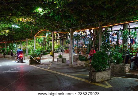 Budva, Montenegro - September 13, 2017: Unknown People Are Sitting On Benches Near Bus Station Build