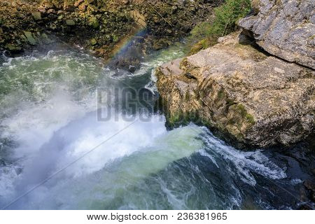 Rainbow Over Saut Du Doubs Biggest Waterfall In The Region Of Doubs Border France Switzerland