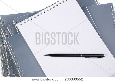 Notebooks With Metal Spiral On White Background