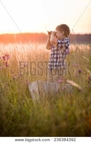 Boy Seaman Floats On A Sailing Boat In The Field At Sunset On A Warm Evening Summer. Dreams Of Trave