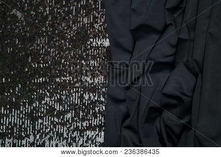 Dark Background Of Black Fabric And Black Shiny Sequins