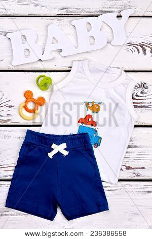 Baby Boy Fashion Boutique Garment. Little Boy Cute Brand Shorts And T-shirt, Teether, Pacifier, Whit